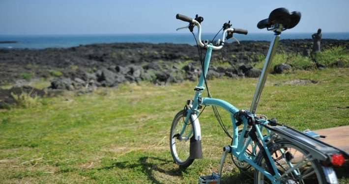 A folding electric bike by the sea
