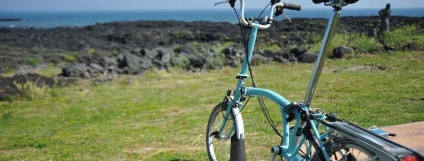 A folding electric bike by the sea